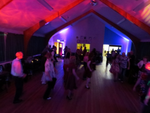 Swing Dancing under coloured lights